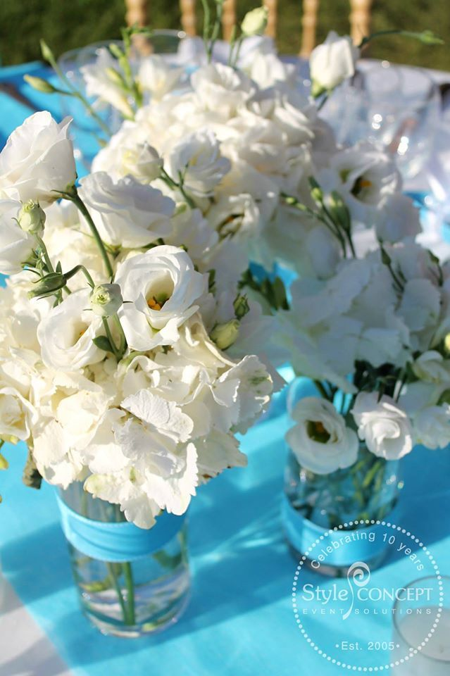 Lovely white flowers in a 3-piece arrangement combined with #turquoise runners & ribbons!