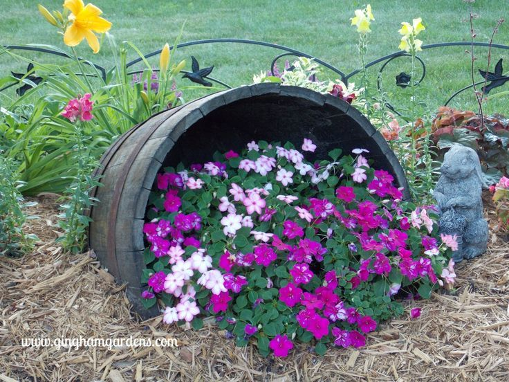 Creative Flower Container Gardening Impatiens Spilling Out Of A Tipped Wine Barrel Container Gardening Flowers Wine Barrel Garden Barrel Flowers