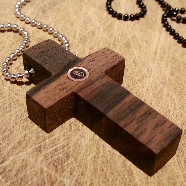 IMNLV Makassar wood cross necklaces.