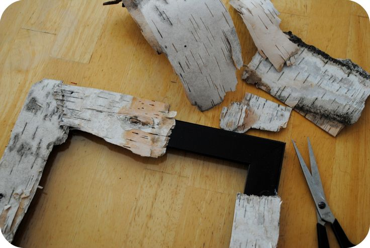 Piecing together the birch bark to create a rustic and natural ...