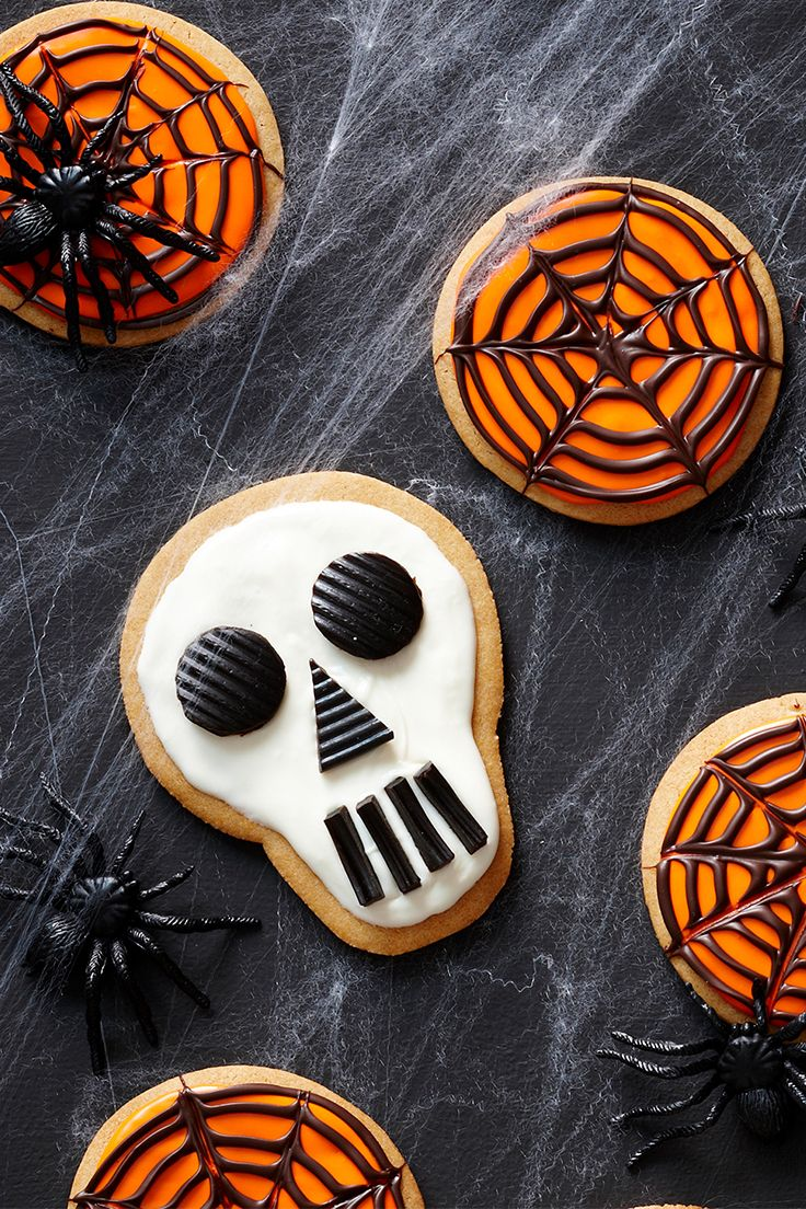 These festive skull and cobweb cookies are the perfect addition to this year's Halloween party!