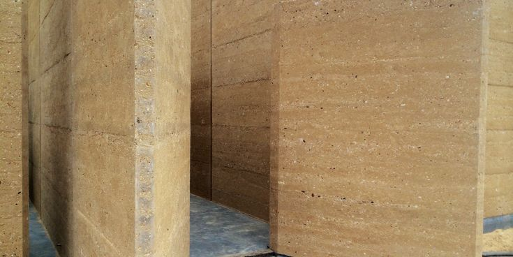 Ian Sercombe Architect- rammed earth home Wingello NSW. These walls look like they've been unearthed in an archaeological dig rather than having been recently built.