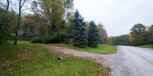 5 acres of wooded land that has a pond is is perfect for a walkout close to downtown Brighton and Howell Contact listing agent regarding a builder contact for some home options.