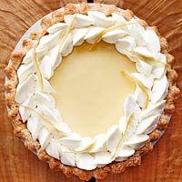 portionAlan's Pie Pastry (recipe below), or 1 rolled refrigerated unbaked pie crust  1 teaspoonunflavored gelatin  2 tablespoonscold water  6 egg yolks  1 1/2 14 ouncecansweetened condensed milk (2 cups)  1/4 cupwhipping cream  1/4 teaspoonsalt  3/4 cuplemon juice  Whipped Cream  Thin lemon peel slivers