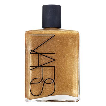 Nars: Body Glow: Hermoso gloss en un empaque con tubo y esponja para aplicarlo fácilmente.