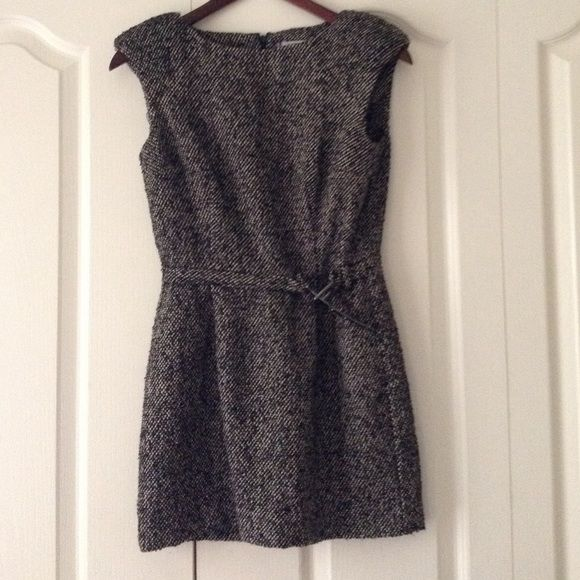 Winter dress Black , gray and beige winter dress by Jennifer Lopez. Features hard ware belt on front with some scratches. Back zip. Shoulder padded perfect for Winter time with some black leggings and a determined walk. Worn one time to a holidays party Jennifer Lopez Dresses Mini