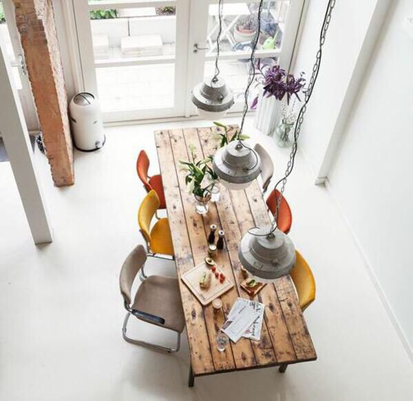 Home Decoration Ideas: Create A Unique Dining Area With Multicoloured Chairs, Offsetting A Minimalist White Interior.