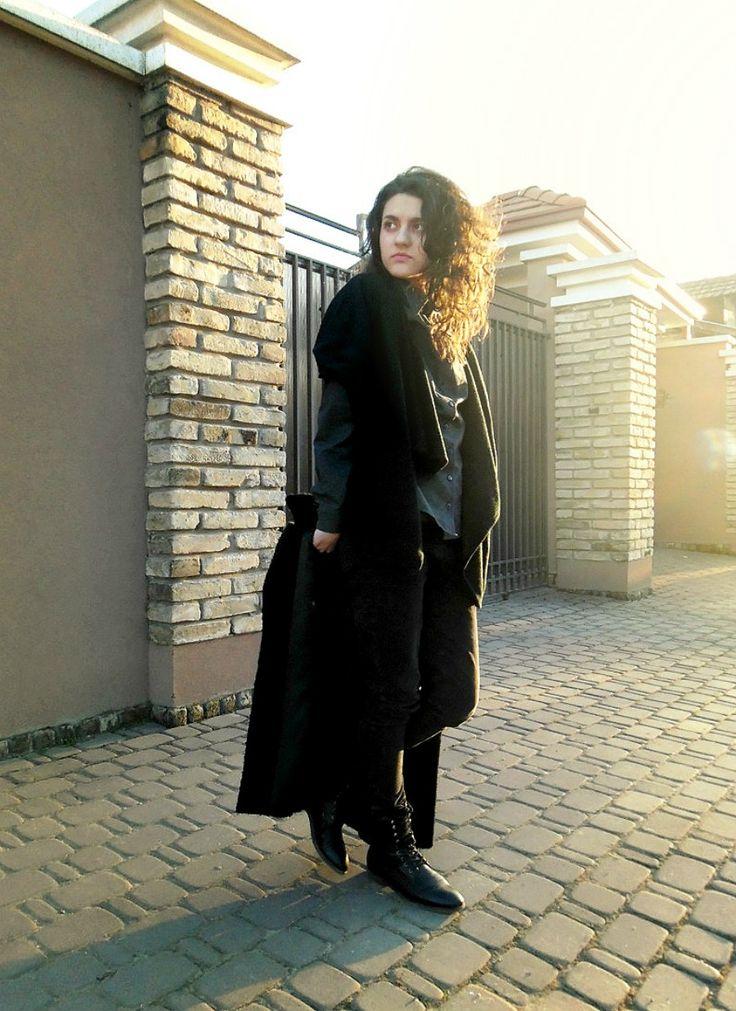 Shop this look on Lookastic:  http://lookastic.com/women/looks/boots-pea-coat-vest-dress-shirt-skinny-pants/8865  — Black Leather Boots  — Black Pea Coat  — Black Wool Vest  — Grey Dress Shirt  — Black Leather Skinny Pants