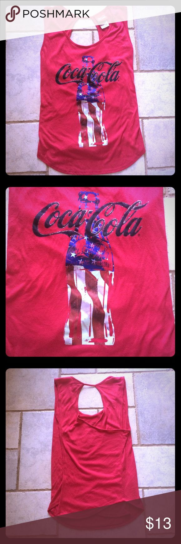 Coca Cola 4th of July Tank Top with open wrap back Coca Cola brand tank top in a 4th of July Theme- Red with a Coke Bottle designed with the American Flag. Size Large in Juniors, 11-13. In gently used condition although it does have a tiny bit of wash wear. No stains or rips. Measurements available upon request 🤗🤗 Coca Cola Tops Tank Tops