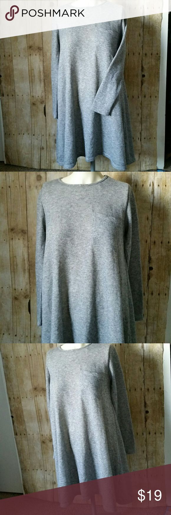 """Peach Love California Sweater Knit Dress Small Heather gray knit long sleeve sweater dress. Would also work as a tunic.  On the lighter side. Pocket at the fitted bust and flows into a relaxed shape. Preowned in good condition with no rips, holes, tears or stains. Size small  Pit to Pit 18.5"""" Top of shoulder to bottom hem 35"""" Peach Love California Dresses"""