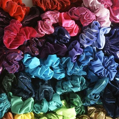 Scrunchies...A thing of the 90's. We wore them as bracelets when they were in your hair and in the later 90's they moved from your wrist to up our arms, just above the elbow.