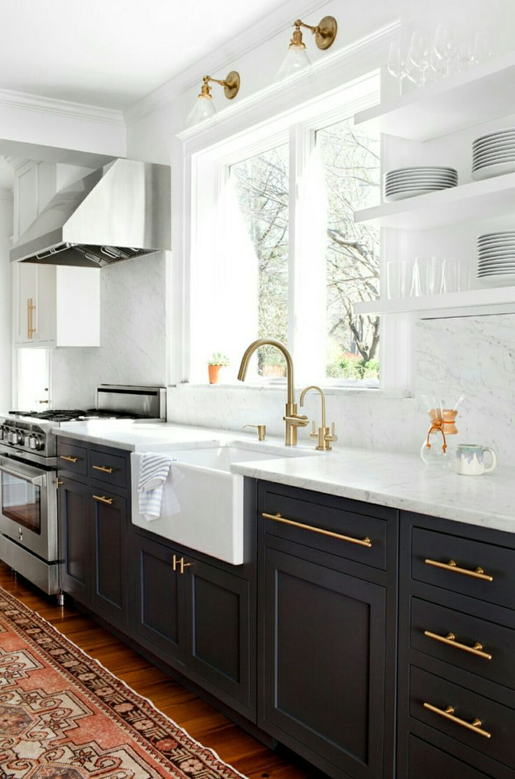 Dark base cabinets, white walls, white marble countertops and backsplash, open shelving, brass fixtures and cabinet pulls, wood floors and a rug! Most popular kitchen photo on Houzz.com.