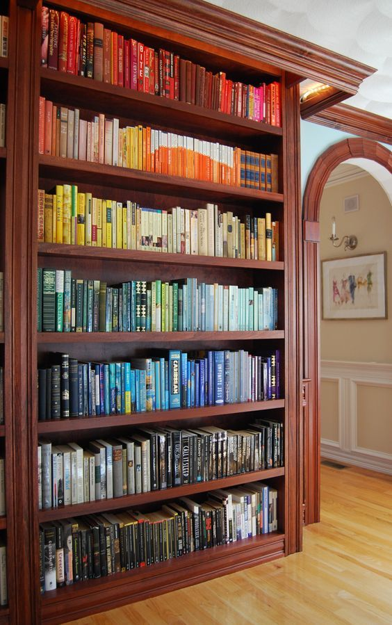 Looking for bookshelf ideas? This eye-catching way of organizing bookshelves is sure to wow guests of your home library.