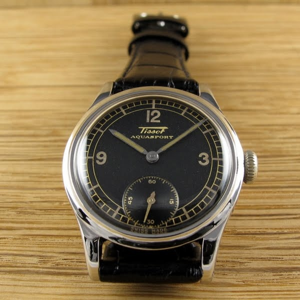 Black bough tissot 39 aqua sport 39 circa 1941 a rare mid size stainless steel wristwatch with for Celebrity tissot watch