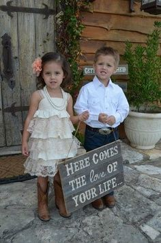 I would have my ring bearer (son) hold this sign and then my flower girl (daughter) w/a sign that says mommy is coming too! lol