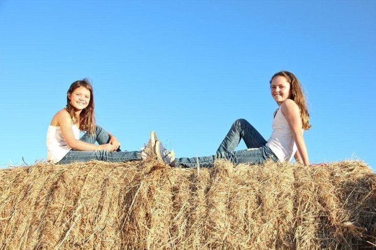 Farm fun family photo outdoor sisters