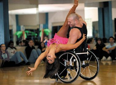 Aubree Marchione and Nick Scott perform the samba during one of Rowan University's Disability Awareness Week events.