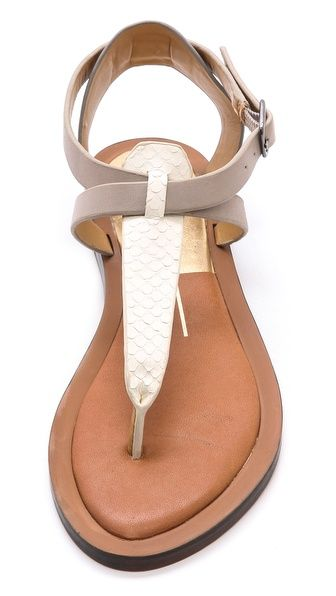 Sandal | A snakeskin T-strap lends luxe texture to colorblocked leather Dolce Vita sandals. Buckle closure. Rubber sole.