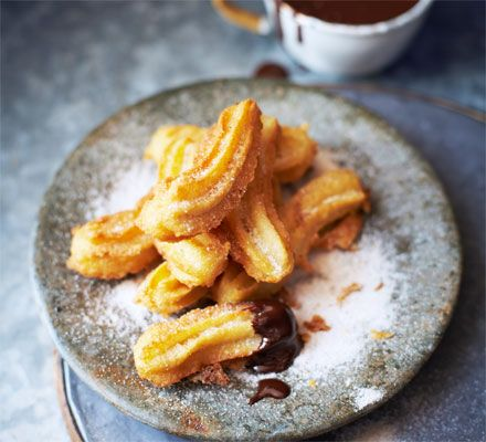 Try a fresh spin on doughnuts by piping them Spanish-style and serving with a thick and indulgent dark chocolate sauce