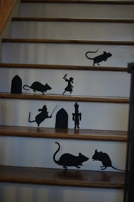Nutcracker Christmas Stairway Silhouettes! Take Martha stewart Halloween rats and cut out your own nutcracker and little girl! :) I LOVE CHRISTMAS!