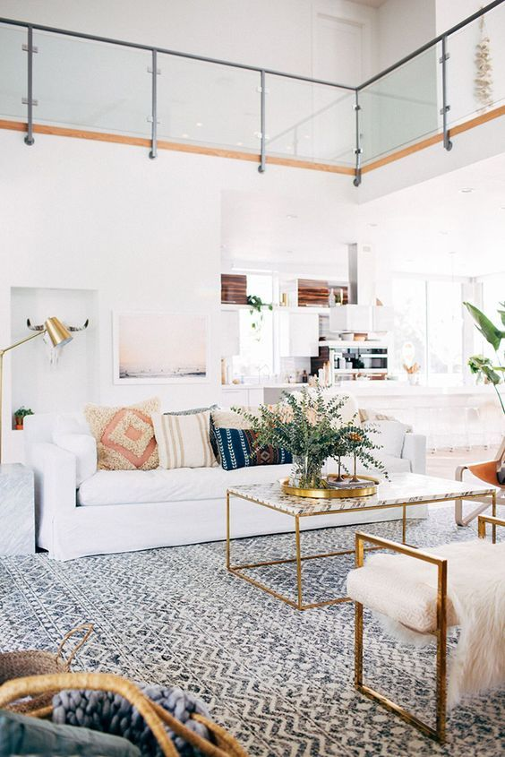 Beautiful white and gold living room. Did anyone spot the beautiful white sheep skin on the chair? #bohostyle #modern #contemporary #arearug #ecarpetgallery #carpet #white #gold