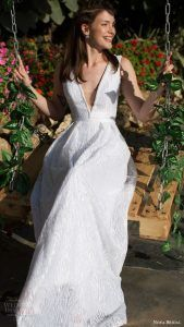 modern deep V-neck wedding dress with a sparkle