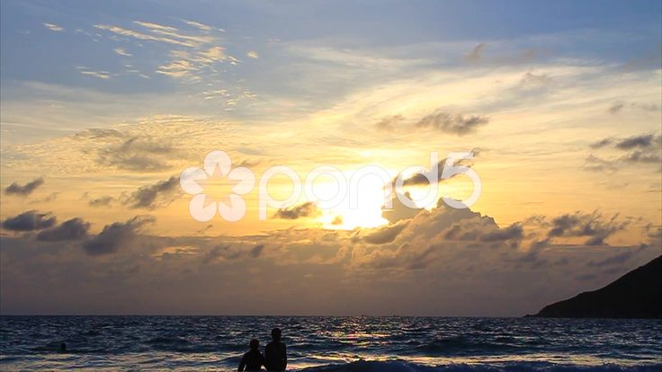 Beach Sunset Sky Clouds Sea Ocean Waves Sun Island Couple Wide Slow-motion - Stock Footage   by RyanJonesFilms #thailand #travel #beach #ocean #sea #waves #trees #palmtrees #cliff #tropical #island #hot #weather #holiday #video #rocks #sand #tide #coast #sunset #dusk #sun #couple #silhouette