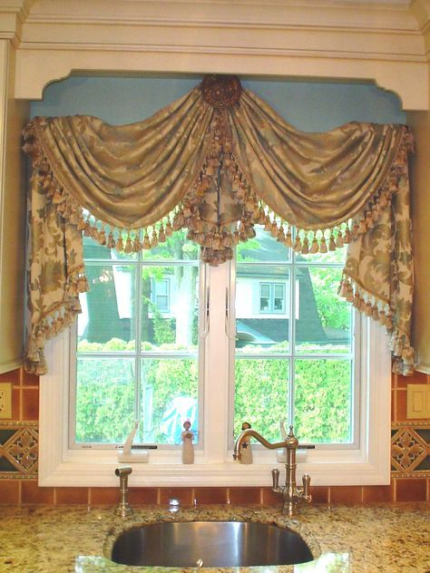 Instead of just a valance or curtains, why not hang a swag from a center medallion over your kitchen window? If you live in Minneapolis, we can get you started on this look with the right #ReplacementWindows. http://www.replacementwindowsmpls.com/
