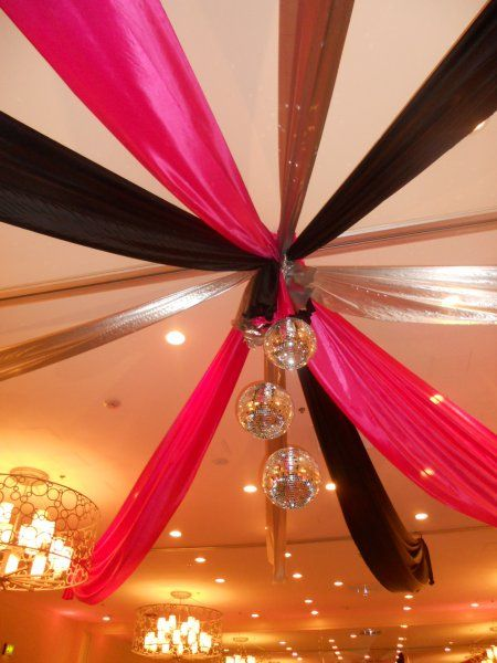 Beautiful ceiling treatment in black, silver and fuschia to match the table decor.    Decor by DM Events & Design  www.dmeventsanddesign.com