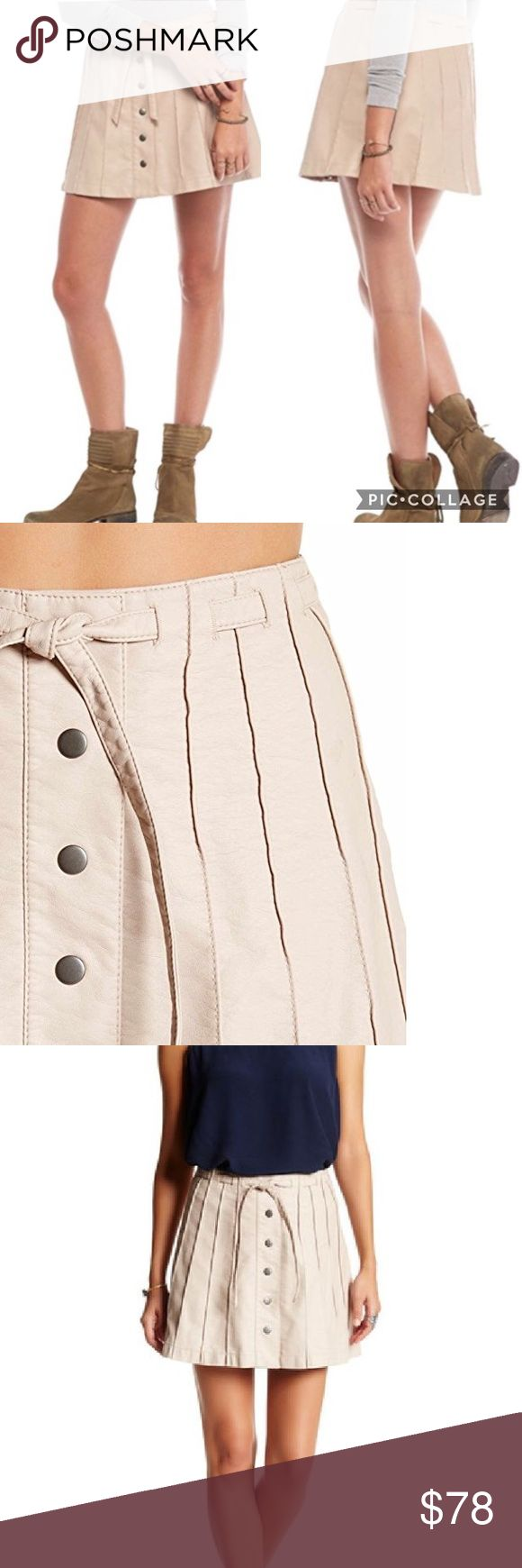 "😍 Free People Vegan Leather Mini Skirt Brand new with tags Free People faux leather miniskirt! Such a great piece, with unique details like the pleats, buttons, and tie around the waist. A neutral color that's super easy to pair with other items in your wardrobe! The color according to free people is ""pink"" but I would say it's definitely more of a nude/tan color with a pinkish-tone. Please feel free to ask your any questions before purchasing. I am open to reasonable offers and give great…"