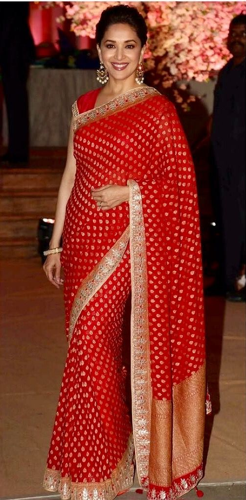 Madhuri Dixit still looking beautiful in a Anita Dongre saree.