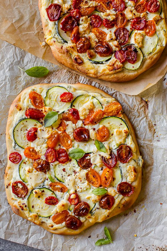 Easy homemade flatbread pizza topped with summery zucchini, herbed ricotta, roasted tomatoes, and fresh basil. So much flavor! Recipe on sallysbakingaddiction.com