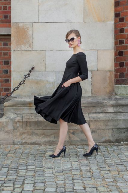 Black dress with a boat-neckline