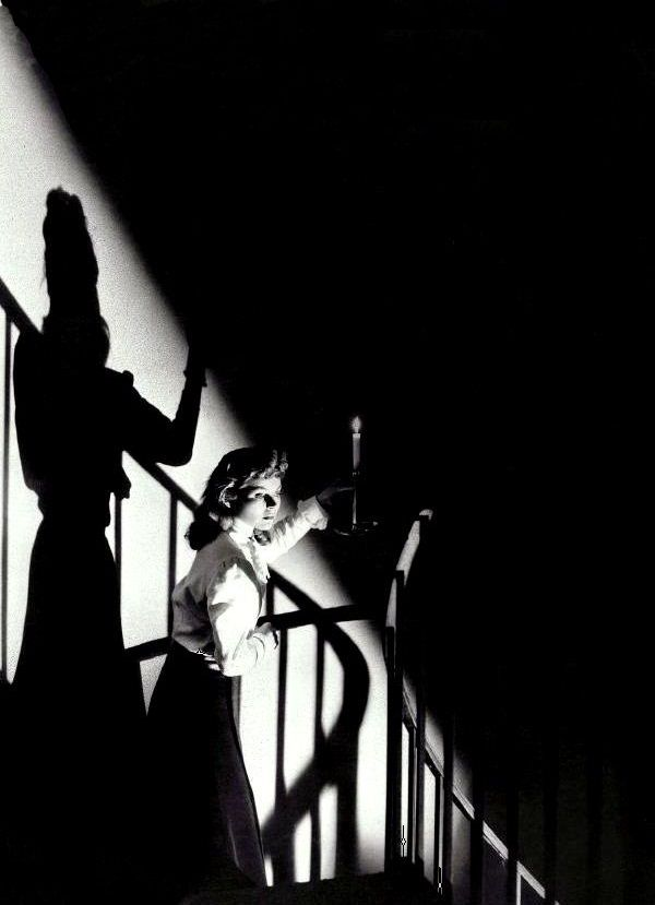 """Dorothy McGuire in The Spiral Staircase (1945, dir. Robert Siodmak) - """"The wind shrieked, as though a flock of witches sailed overhead, racing the moon, which spun through the torn clouds like a silver cannonball, shot into space. Down in the basement, a flickering candle in her hand, she groped amid the mice, the spiders, and the shadows..."""""""