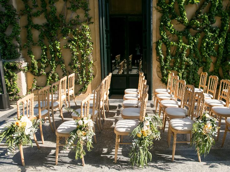 Ceremony bouquets tied to the aisle chairs