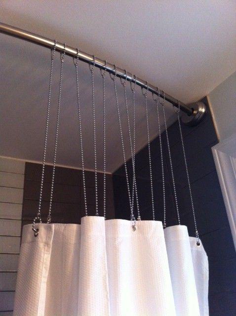 Rather than traditional shower curtain hooks, and we can hang the rod right to the ceiling to give the illusion that the ceiling height is much higher.