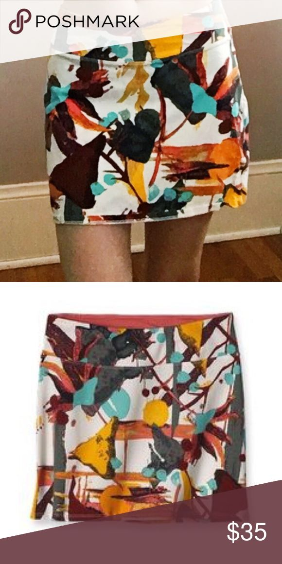 """Patagonia Mini Skirt Colorway: River Queen / Pickled Ginger  Patagonia's Tidal Skirt features: Organic stretch cotton fabric (95% organic cotton/5% spandex). Flattering, wide self-fabric waistband has inside contrast panel. Length (size M) is 16"""" waist to hem. FEATURES  Organic stretch cotton fabric is super soft Simple pull-on design Flattering, wide, self-fabric waistband has inside contrast panel Made in Turkey. Patagonia Skirts Mini"""