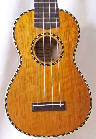 This soprano ukulele features a solid mango top, back & sides, gloss finish, genuine bone nut & saddle, rosewood fretboard & bridge and sealed gear tuners.