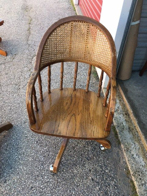Vintage office furniture available to rent through Bygone Theatre. Vintage 1960s wooden chair with rattan back – spins, on wheels.