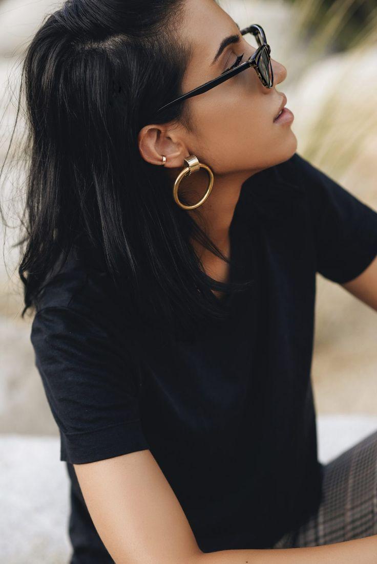 Chunky gold hoops of fashion blogger Tania Sarin