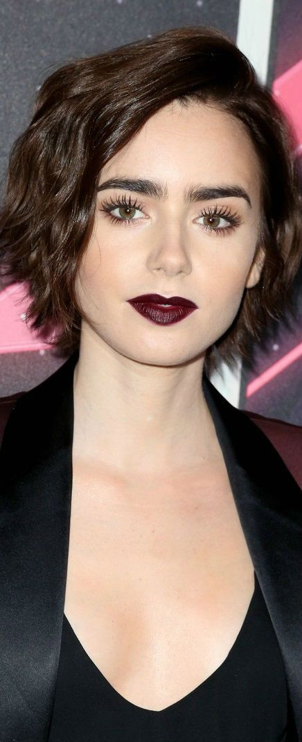 Lily Collins - I really don't think I look like her. Maybe it's bc we've both got big eyes & eyebrows?