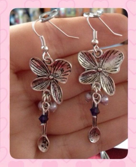 I adore these Spoonie Earrings with Butterfly Flower. With the purple beads and symbolic charms, it would be great for representing, subtly, fibromyalgia or lupus.  by KDSerenityCreations
