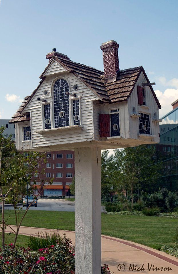 Thomas F. Burke makes beautiful reproductions of real houses --or ones from paintings-- into birdhouses.