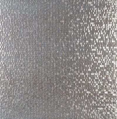 I am obsessed with this Porcelanosa Cubica tile for our kitchen backsplash.