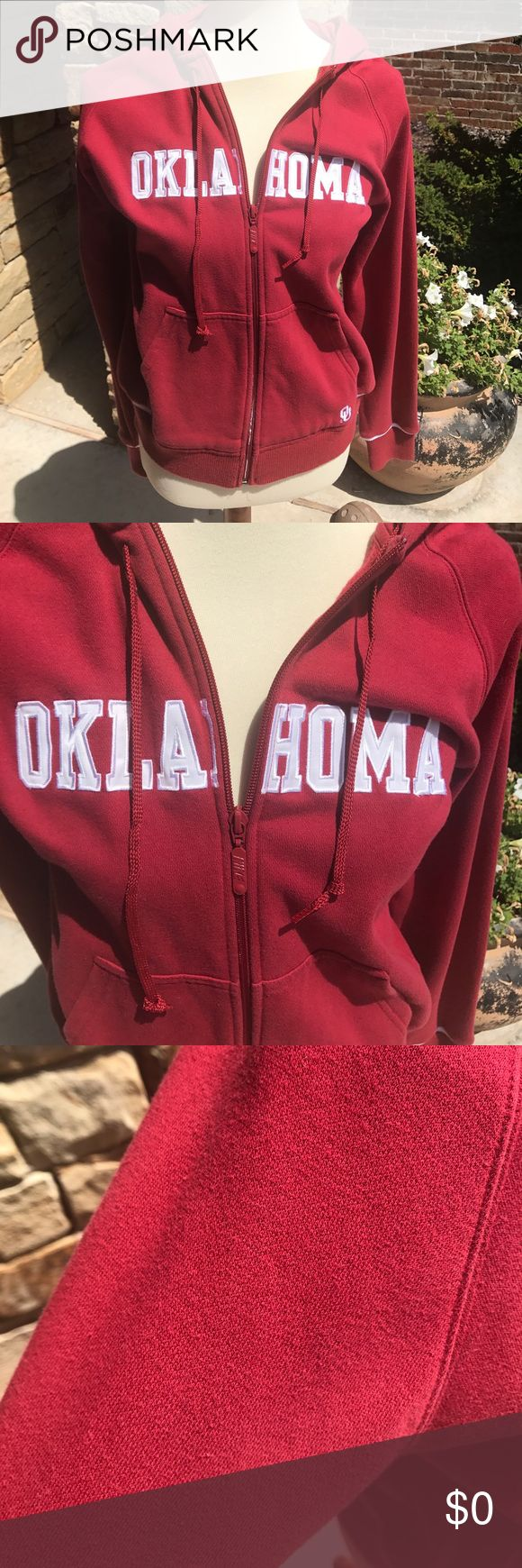 Boomer Sooner! Women's Nike zip up hoodie with Oklahoma stitched across chest. White stripe at bottom of hoodie and sleeves. Light wear and piling. Nike Tops Sweatshirts & Hoodies