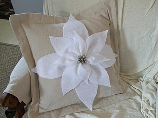 Felt (?) Poinsettia. I bet you could make other flowers for non-Christmas pillows.