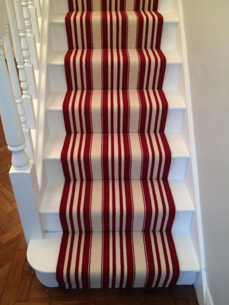Beautiful stair carpet with that bold red look.