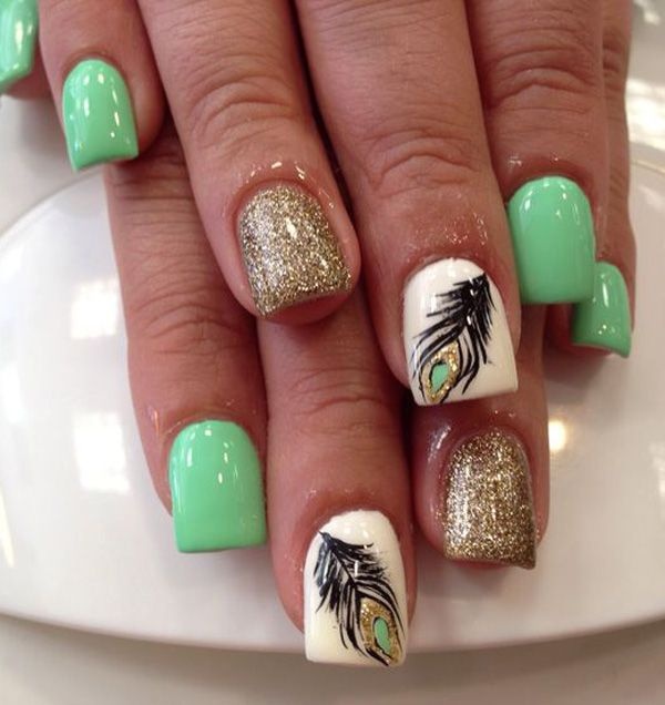Attractive looking olive green gold glitter and feather nail art. Paint your nails in olive green polish and pair with peacock feathers on white polish and gold glitter nails.