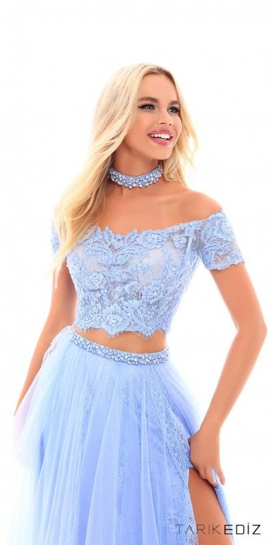 Be the crowds desire and leave a lasting impression in the striking Short Sleeve Off the Shoulder Two Piece Prom Dress by Tarik Ediz Prom. This two piece stunner features an off the shoulder neckline, short sleeves, a lace bodice with a beaded choker and an a-line skirt with a thigh high slit. #edressme