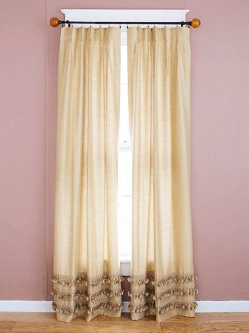 Add a Border  Dress up plain curtain panels with decorative fringe found at a crafts store. Choose trim in the same color as the panel for subtle drama.